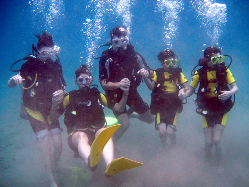 Family Group enjoying their first dive